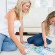 Mother and daughter doing a jigsaw — Stock Photo