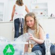 Daughter sorting plastics — Stock Photo