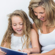 Royalty-Free Stock Photo: Happy mother and daughter looking at tablet pc