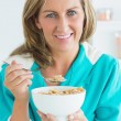 Woman eating cereals — Stock Photo #23489201