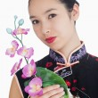 Smiling woman with orchid — Stock Photo