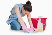 Serious cleaning woman wiping up the floor — Stock Photo