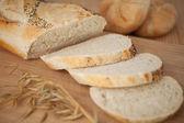 Sliced poppy seed baguette — Stock Photo