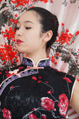 Geisha style woman with fan — Stock Photo