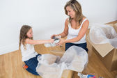 Mother and daughter unpacking things — Stock Photo