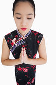 Woman wearing kimono with hands together — Stock Photo