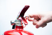 Pulling pin of fire extinguisher — Stock Photo