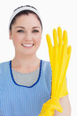 Cleaner woman wearing yellow gloves — Stock Photo