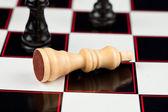 White chessman lying — Stock Photo