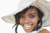Woman wearing summer hat smiling — Stock Photo