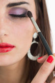 Woman applying smoky eyes — Stock Photo