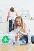 Daughter sorting plastics — Stock Photo