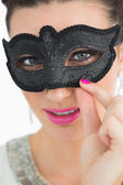Woman wearing a black mask — Stock Photo