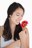 Woman in pigtails holding flower — Stock Photo