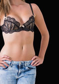 Sector of bra and jeans — Stock Photo