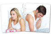 Angry couple sitting against each other — Stock Photo
