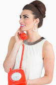 Sixties style woman using dial phone — Stok fotoğraf