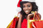 Festive woman standing looking while holding bags — Stock Photo