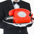 Red dial phone on silver tray — Stock Photo #23490043
