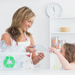 Mother sorting waste with her daughter — Stock Photo
