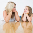 Resting mother and daughter on the floor — Stock Photo #23490591