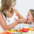 Mother feeding her daughter  — Stock Photo