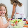 Girl preparing vegetable salad — Stock Photo
