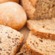 Wholemeal bread lying on the background — Stock Photo #23491995