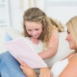 Mother showing something to her daughter — Stock Photo