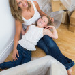 Mother and daughter resting after unpacking — Stock Photo