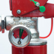 Close up of top of fire extinguisher - Stock Photo