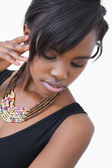 Woman posing in tribal style necklace — Stock Photo