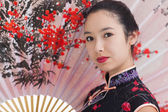 Woman dressed in geisha style — Stock Photo