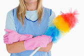 Cleaning woman holding feather duster — Stock Photo