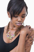 Woman wearing tribal style necklace — Stock Photo