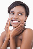 Happy woman putting on face cream — Foto Stock