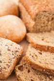 Wholemeal bread lying on the background — Stock Photo