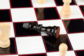 Black chessman lying — Stock Photo