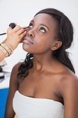Makeup artist applying eyeliner — Stock Photo