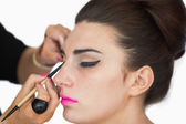 Woman getting applied cat eyes — Stock Photo