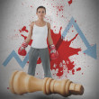 Female boxer against loss arrow and blood spatter with fallen chess piece - Stock Photo