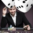 Handsome gambler with digital dice — Stock Photo #24059151