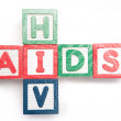 Wood blocks spelling aids and hiv in a cross shape — Stock Photo