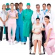 Nurse with pregnant woman in wheelchair with medical staff — Stock Photo