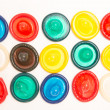 Many different coloured condoms - Stock Photo