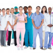 Happy team of smiling doctors standing together — Stockfoto