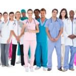 birlikte duran doktor gülümseyerek mutlu takım — Stok fotoğraf