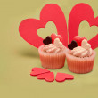 Two valentines cupcakes with  five heart decorations — Stock Photo