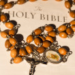 Stock Photo: Rosary beads on page of bible