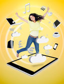 Cute woman jumping on a tablet pc — Foto Stock